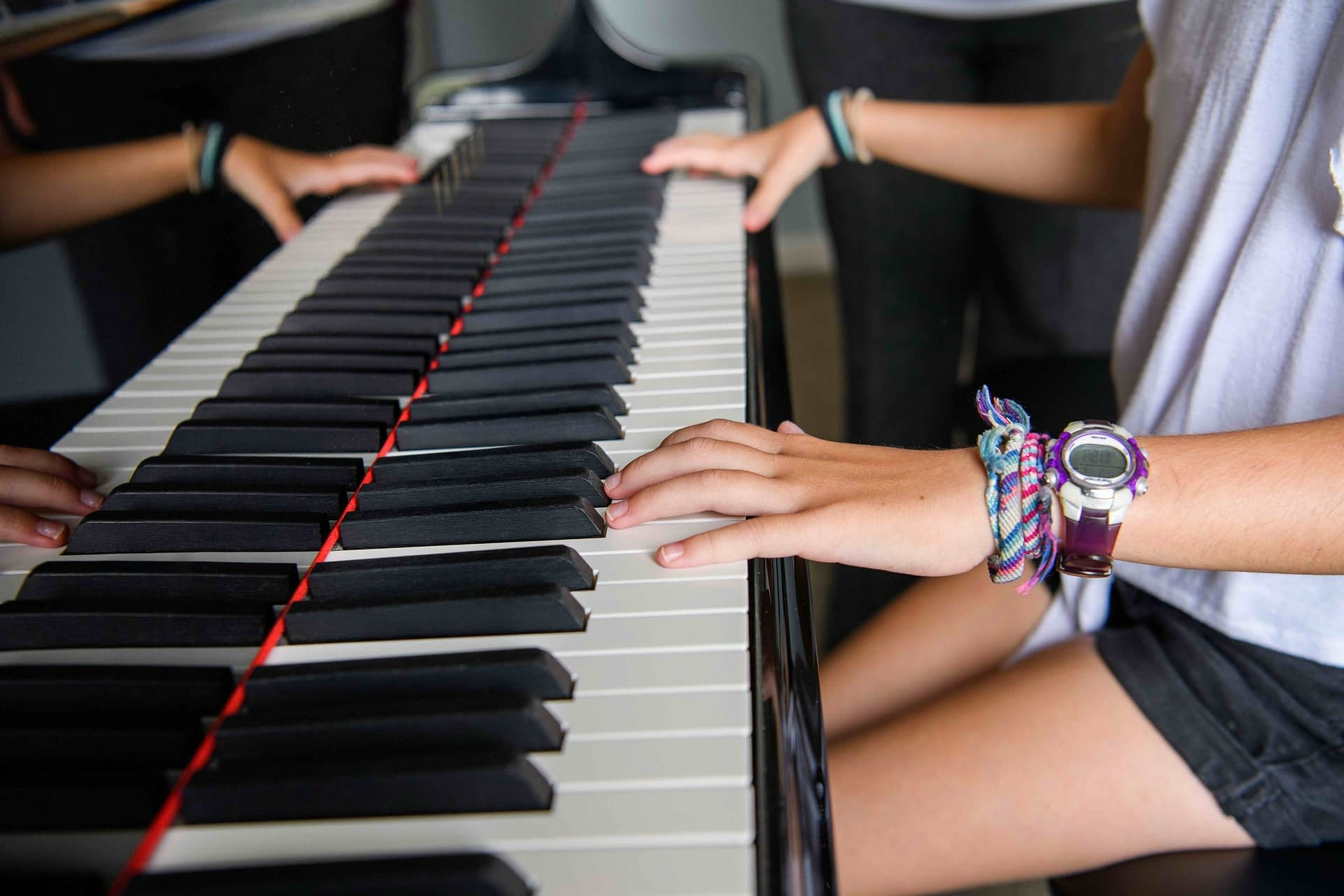 Recreational piano student hands