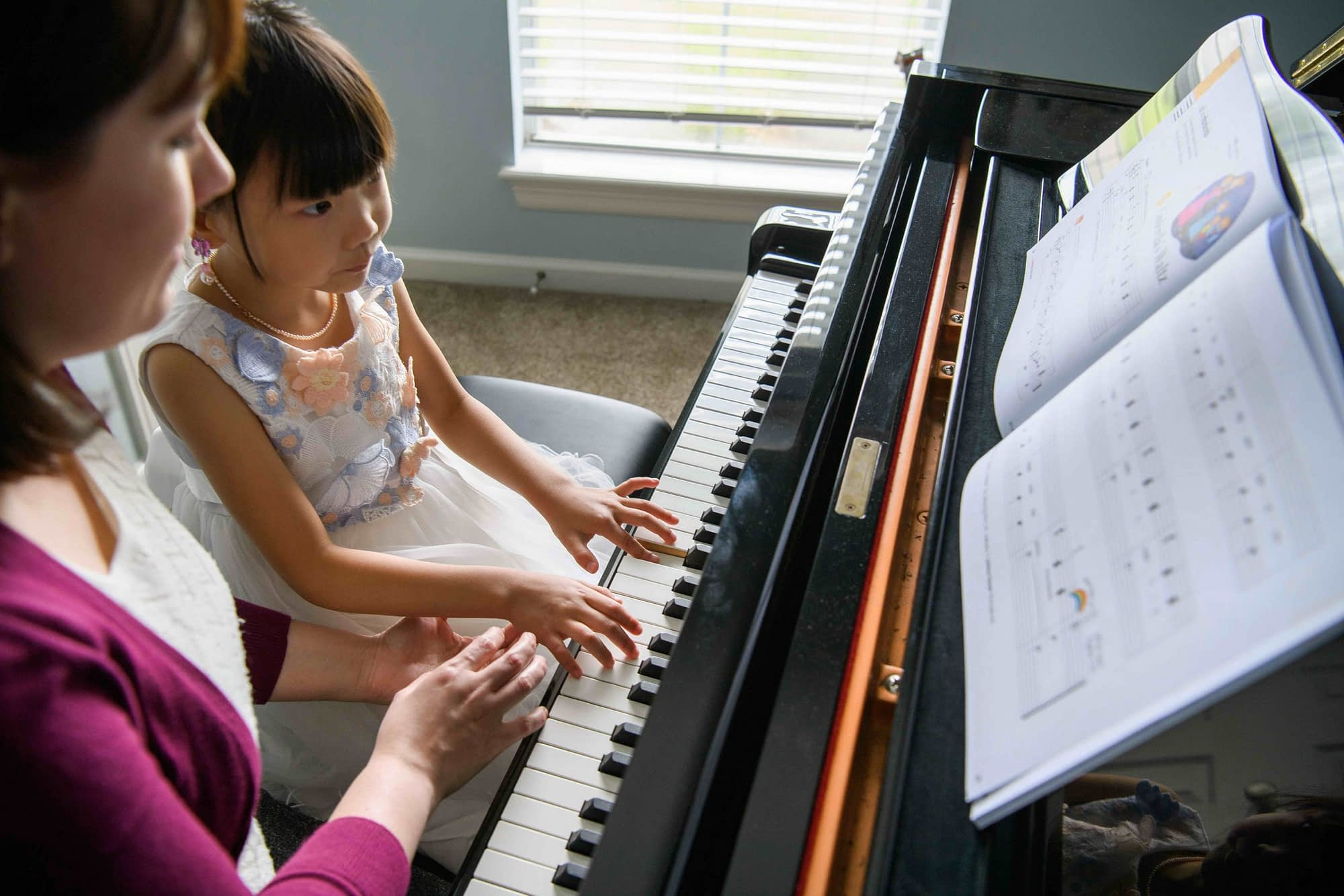 Young child piano lesson with teacher