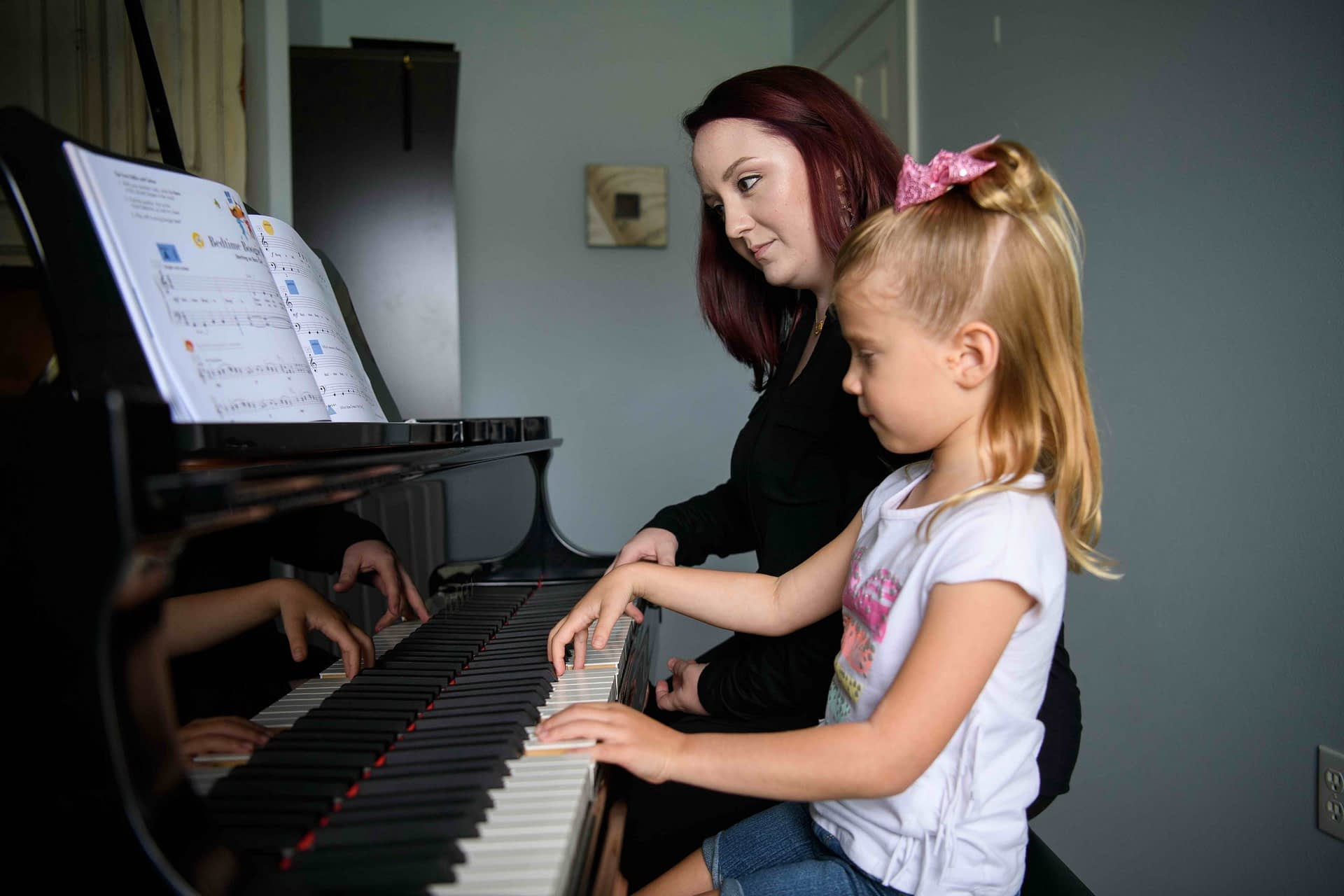 Teacher and young student piano lesson