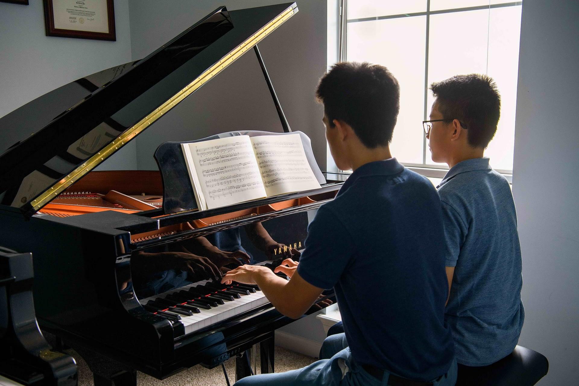 High school piano duet students