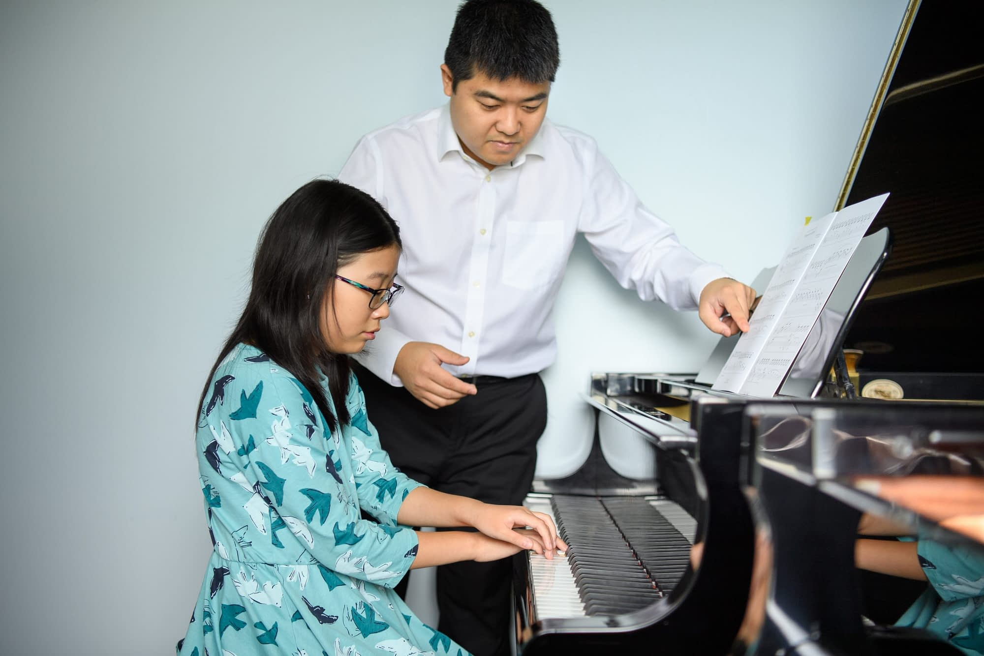 Student playing piano in group class