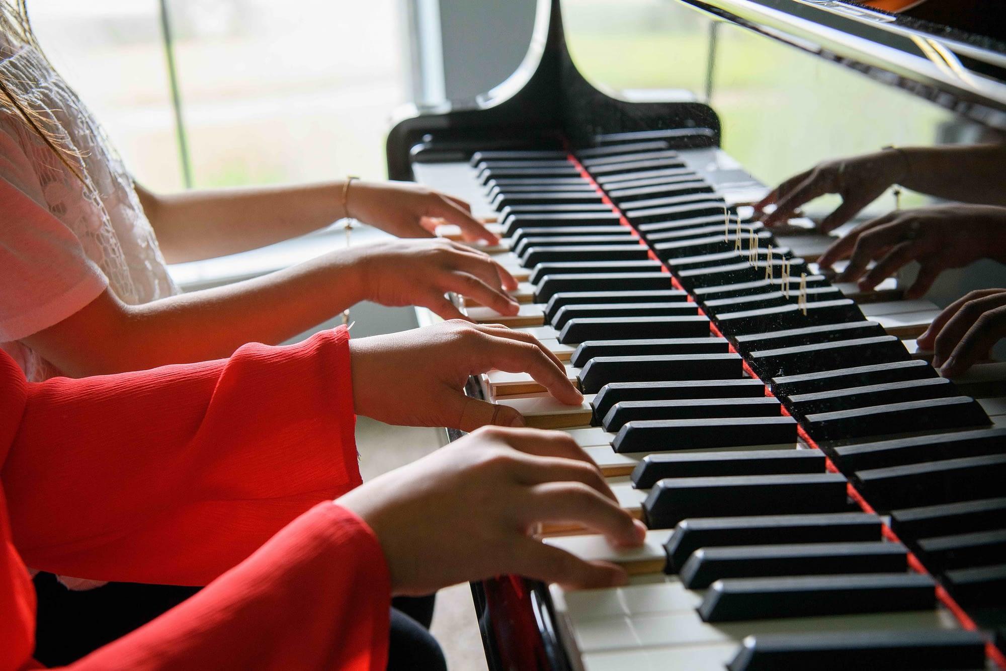 Piano students duet hands