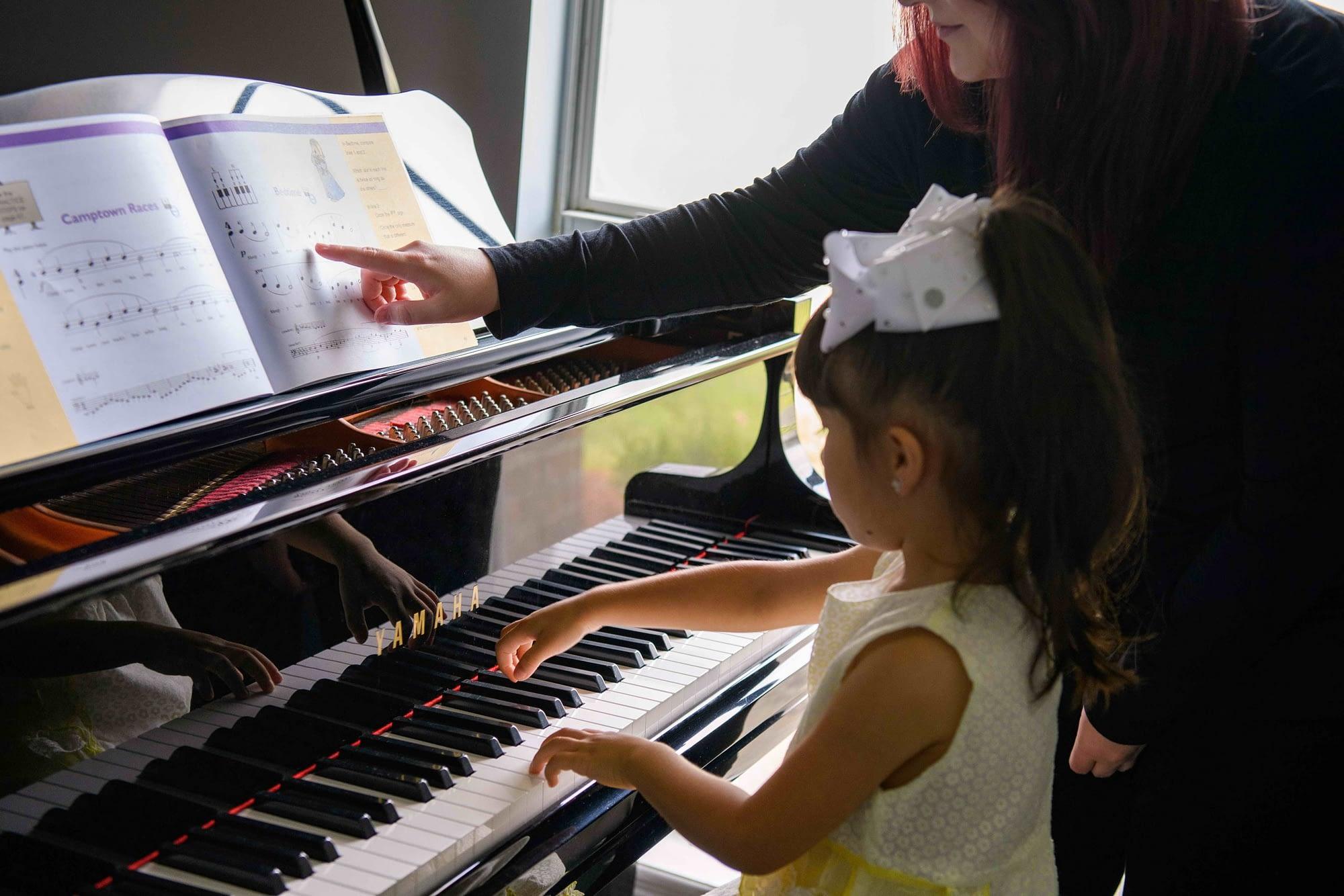 Preschool piano lesson with teacher