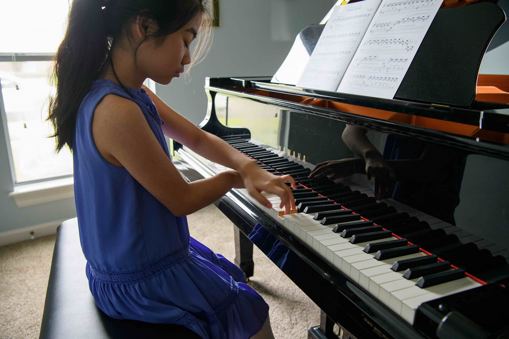 Child piano lesson