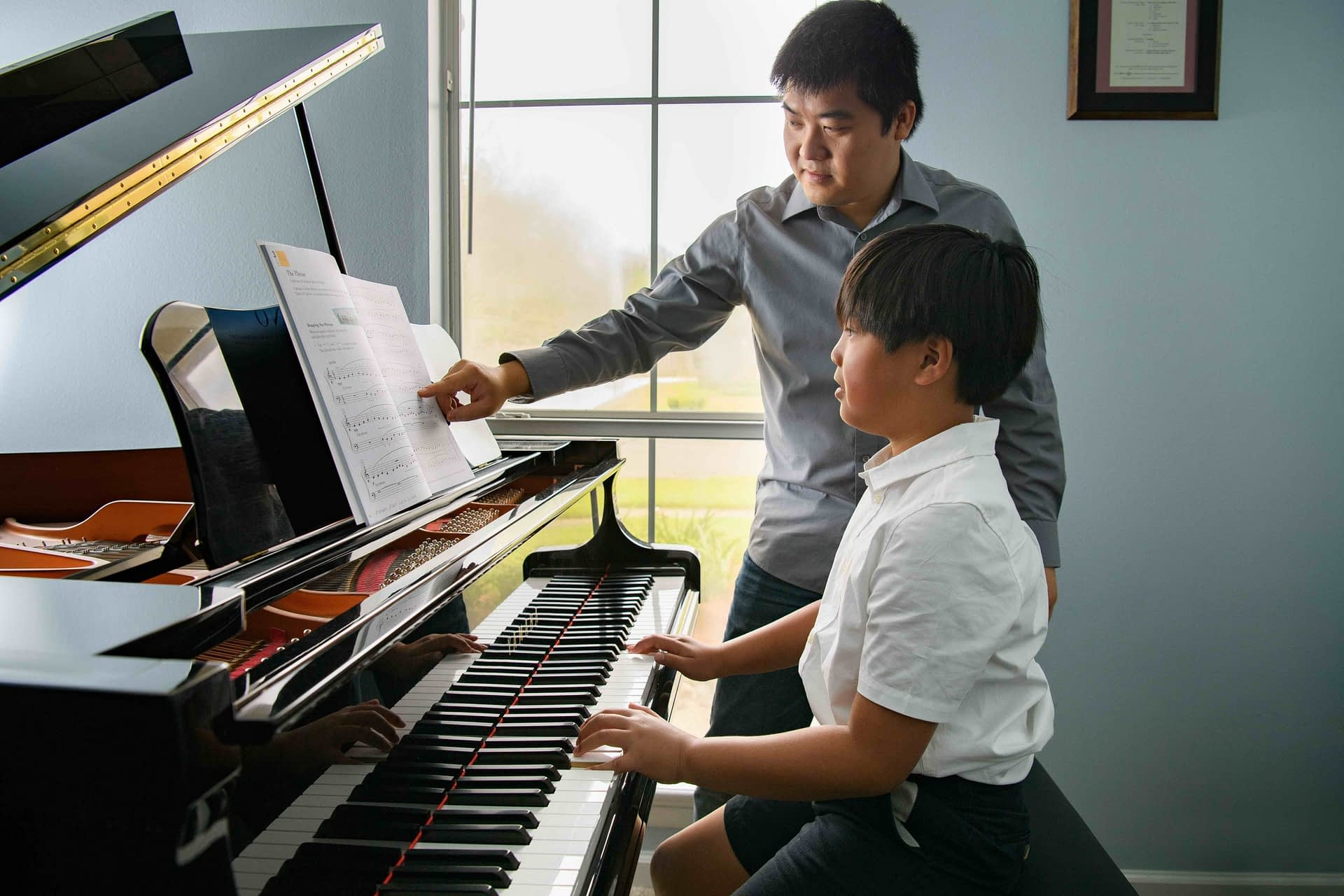 Piano students with trophies