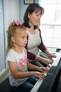 Piano teacher with student